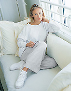 Picture of Luba relaxing on a couch in a Miami Hotel. Photographed for Boston Proper.