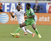 JACKSONVILLE, FL - JUNE 07:  Defender DaMarcus Beasley #7 of the United States chases down defender Eric Efe Ambrose #5 of Nigeria during the international friendly match at EverBank Field on June 7, 2014 in Jacksonville, Florida.  (Photo by Mike Zarrilli/Getty Images)