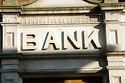 Stone lettering Bank above entrance to building