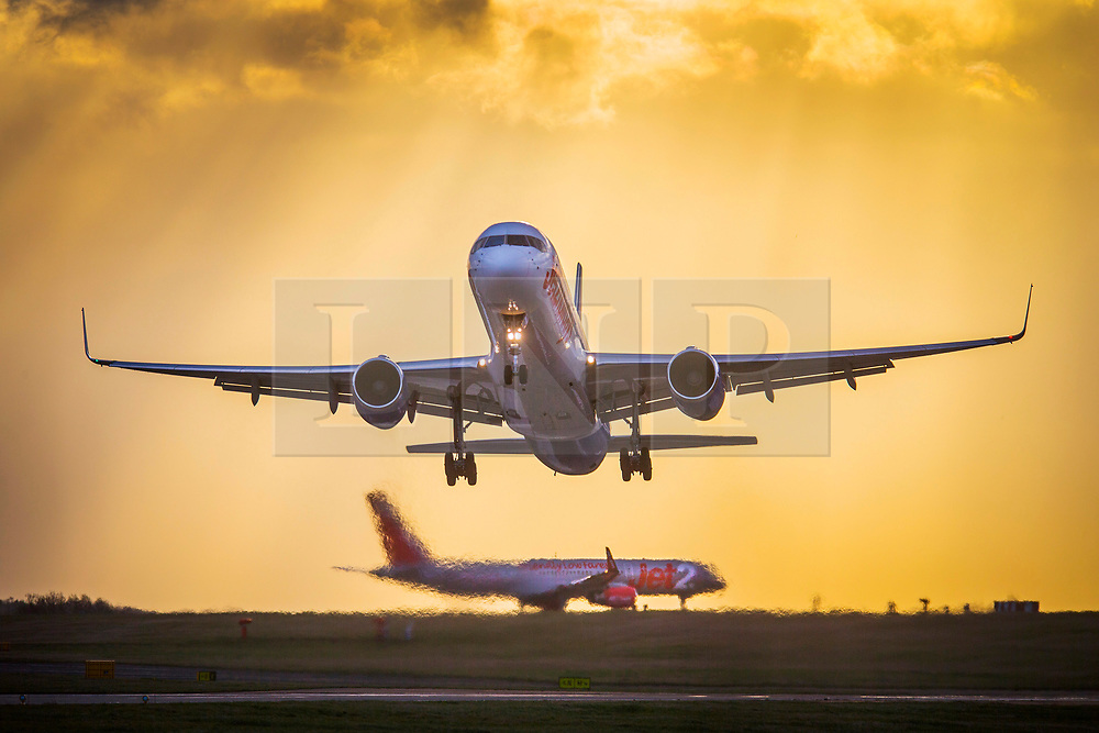 © Licensed to London News Pictures. 27/08/2020. Leeds UK. File picture taken 01/02/2020 of a Jet2 aircraft leaving Leeds Bradford airport. Leeds based airline Jet2 has cancelled all flights to the Balearic Islands for the remainder of summer, and it has extended the suspension of package holidays and flights to mainland Spain and the Canaries until September 13. Photo credit: Andrew McCaren/LNP