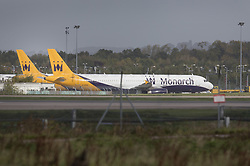 © Licensed to London News Pictures. 02/10/2017. Crawley, UK. Two Monarch Airlines aircraft are seen parked at Gatwick Airport after it was announced that the airline has ceased trading. The government has announced that it will start the country's biggest ever peacetime repatriation to fly about 110,000 stranded passengers home. Photo credit: Peter Macdiarmid/LNP
