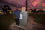 """Corey Lathan, a Baton Roug resdient with  other BLM protesters <br /> resume their protest against poice brutality on Airline Highway across the street from the police station following the killing of Alton Sterling, days after three police officers were killed. """"We want justice, 'Lathan said,"""" The Killing of the officers has nothing to do with those protesting."""