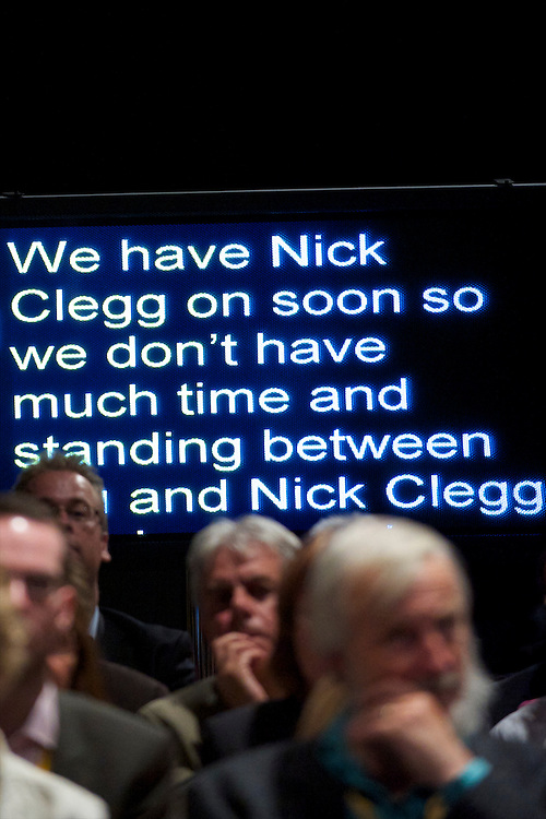 A speaker's telepromter rolls onwards behind the audience with the announcement that Deputy Prime Minister Nick Clegg will soon make his appearance at the Liberal Democrats Autumn Conference in Liverpool on 19 September 2010.  This was the first party conference since the government coalition with the tories.