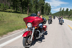 Melissa Shoemaker on the Annual Cycle Source and Michael Lichter Rides (combined this year) left from the new Broken Spoke area of the Iron Horse Saloon during the Sturgis Black Hills Motorcycle Rally. SD, USA.  Wednesday, August 10, 2016.  Photography ©2016 Michael Lichter.