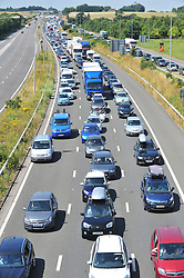 © Licensed to London News Pictures. 23/07/2016<br /> M20 traffic near the Euro Tunnel Service Station at the back of a very very long queue into Dover, kent.<br /> Dover bound traffic ON THE  M20 in Kent at Junction 11A AND 12.  Queueing traffic because of very long delays at French border contol. <br /> <br /> <br /> (Byline:Grant Falvey/LNP)