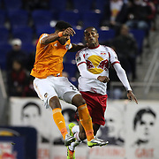 Giles Barnes, (left), Houston Dynamo, wins a header while challenged by Roy Miller, New York Red Bulls during the New York Red Bulls V Houston Dynamo, Major League Soccer regular season match at Red Bull Arena, Harrison, New Jersey. USA. 23rd April 2014. Photo Tim Clayton