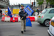 Anti brexit protester Steve Bray crosses Parliament Square as he continues his on going protest outside the Houses of Parliament in London, United Kingdom on 3rd October 2019. Prime Minister Boris Johnson has published his  EU withdrawal agreement with a alternative to the Irish backstop telling EU leaders the UK will be leaving on 31 October with or without a deal.