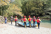 Rafting in Voidomatis river, close to Kleidonia stone bridge, Zagori, Pindus mountains, Epirus, Greece.
