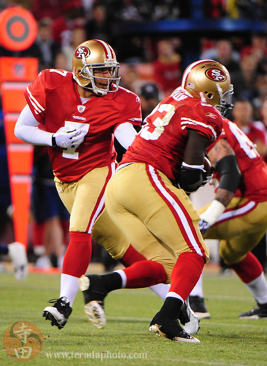 September 2, 2010; San Francisco, CA, USA; San Francisco 49ers quarterback Nate Davis (7) hands the ball off to running back Anthony Dixon (right) during the second quarter against the San Diego Chargers at Candlestick Park. Mandatory Credit: Kyle Terada-Terada Photo