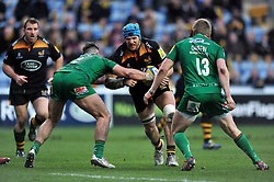 Wasps captain James Haskell takes on the London Irish defence - Photo mandatory by-line: Patrick Khachfe/JMP - Mobile: 07966 386802 21/12/2014 - SPORT - RUGBY UNION - Coventry - Ricoh Arena - Wasps v London Irish - Aviva Premiership