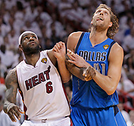 Lebron James and Dirk Nowitzky jockey for position under the basket in the second quarter during Game 6 of the NBA Finals between the Miami Heat and the Dallas Mavericks at the AmericanAirlines Arena on June 12, 2011.