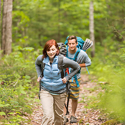 A young couple hiking on The Appalachian Trail in Maine's 100 Mile Wilderness.