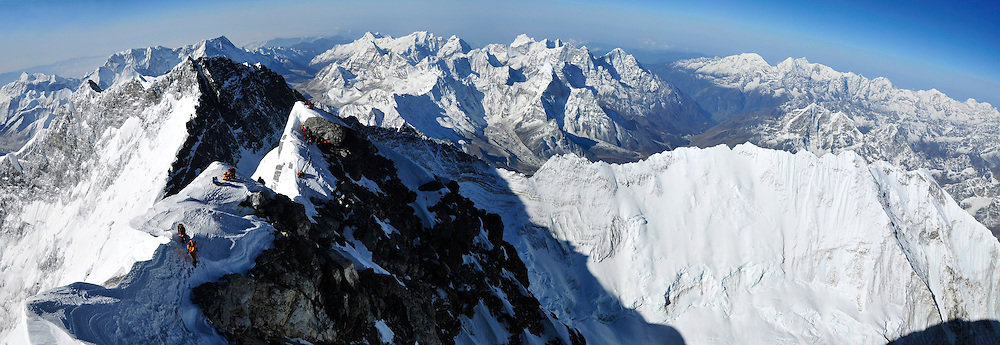 Panorama of climbers ascending the final 250 feet of the Southeast Ridge of Everest as viewed from the top of the Hillary Step, on May 19, 2009.<br /> <br /> To see the fullsize interactive panorama, please visit: http://www.gigapan.com/gigapans/152797.