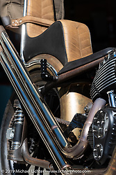 This 2017 Indian Chief Custom named the Mescalero (for a band of Native Americans that experiment with mescaline) Indian Chief Chopper is the only chopper ever built in the RSD shop. It is a modern fuel-injected Indian Thunderstroke powerplant shoe-horned into a hand built single down-tube chromoly, stainless girder forked, plunger rear suspended chassis. Foot clutch, suicide shift and king & queen seat to keep it proper. Parked behind the Roland Sands Design (RSD) retail and office location, Los Alamitos, CA. Monday June 25, 2018. Photography ©2018 Michael Lichter.