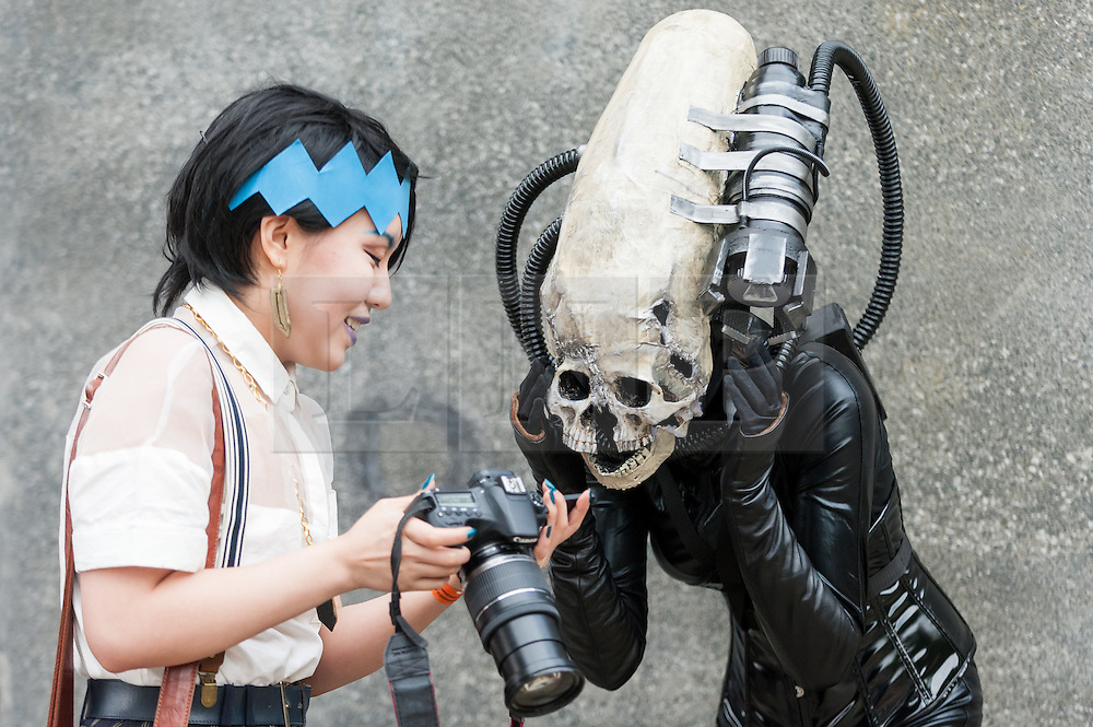 © Licensed to London News Pictures. 29/05/2016. London, UK. A character dressed as an Alien figure has their photo taken, as cosplayers visit the Excel Centre on the last day of the popular MC Comic Con, a three day event celebrating games, anime, movies and more. Photo credit : Stephen Chung/LNP