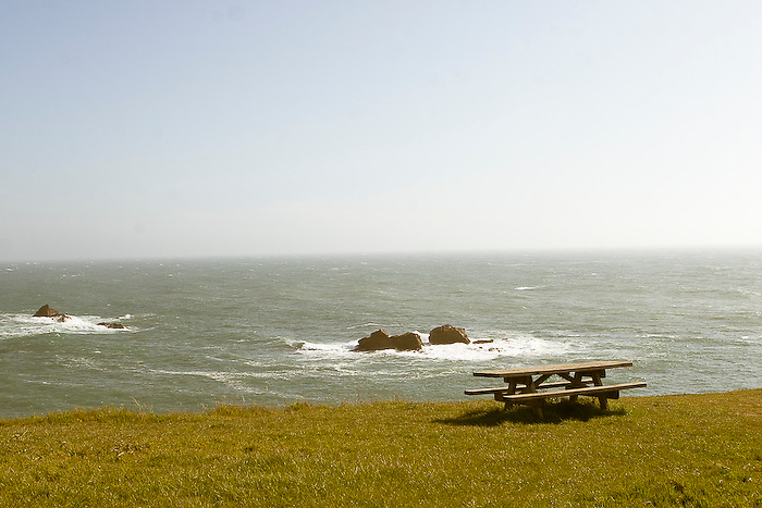 Picnic Table on a grassy field overlooking the Pacific Ocean in Northern California, off of highway 101.
