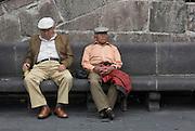 Two men nap on a bench. Quito, Pichincha, Ecuador. February 24, 2013.