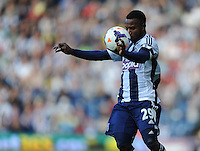 West Bromwich Albion's Stephane Sessegnon showing his ball control skills<br /> <br /> Photo by Stephen White/CameraSport<br /> <br /> Football - Barclays Premiership - West Bromwich albion v Arsenal - Sunday 6th October 2013 - The Hawthorns - West Bromwich<br /> <br /> © CameraSport - 43 Linden Ave. Countesthorpe. Leicester. England. LE8 5PG - Tel: +44 (0) 116 277 4147 - admin@camerasport.com - www.camerasport.com