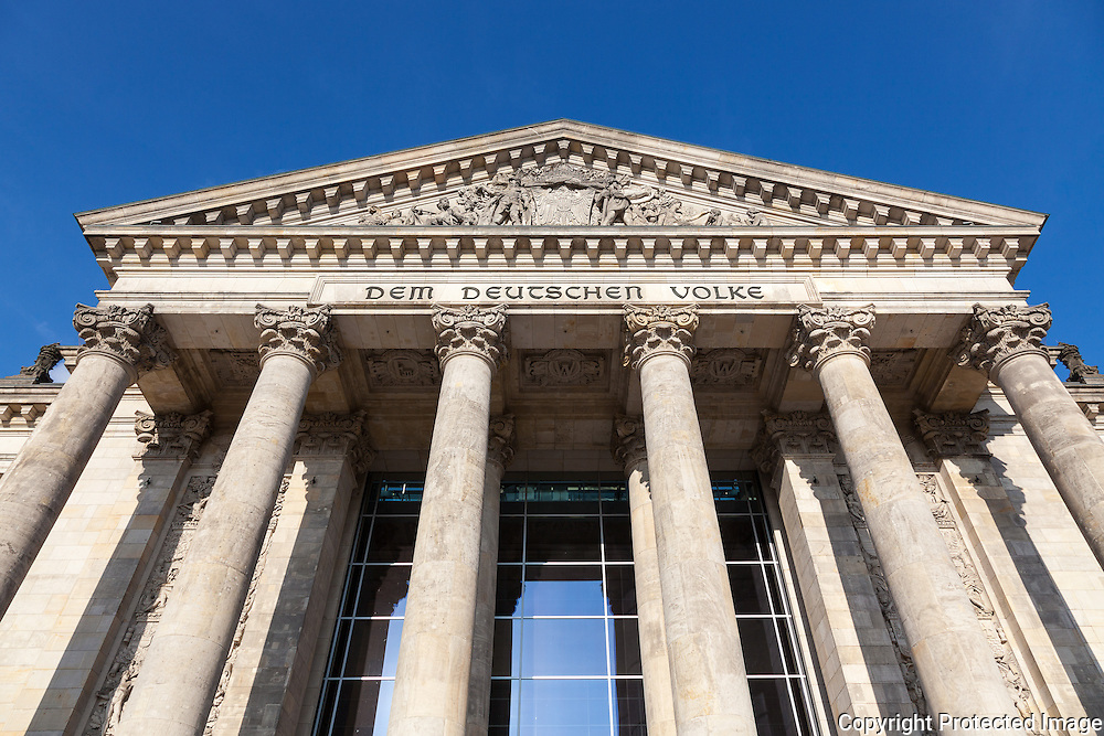 Dem deutschen Volke, meaning To the German people, on the architrave of the Reichstag Building. Architect,1894: Paul Wallot Renovating Architect, 1999: Norman Foster