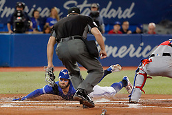April 29, 2018 - Toronto, ON, U.S. - TORONTO, ON - APRIL 29:  Toronto Blue Jays Center field Kevin Pillar (11) slides safely home during the MLB game between the New York Yankees and the Toronto Blue Jays on April 29, 2018 at Rogers Centre in Toronto, ON. (Photo by Jeff Chevrier/Icon Sportswire) (Credit Image: © Jeff Chevrier/Icon SMI via ZUMA Press)