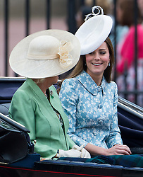 © London News Pictures. 13/06/2015. London, UK.  Camilla, Duchess of Cambridge (left) and Catherine, Duchess of Cambridge, riding in a carriage from Buckingham Palace during the annual Trooping the Colour Ceremony in central London. The event marks the queens official birthday. Photo credit: Ben Cawthra/LNP