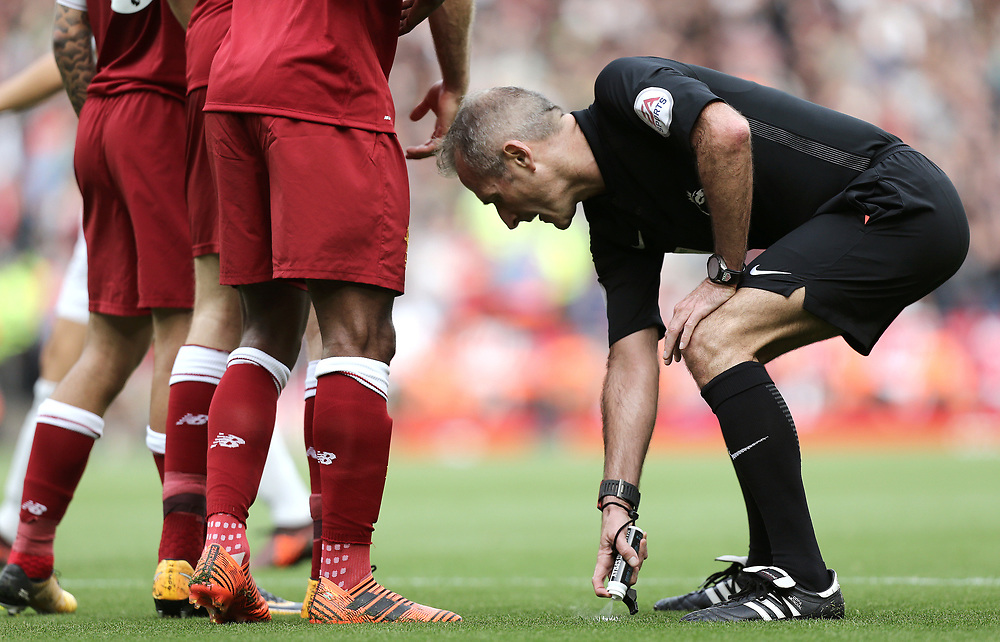 Referee Martin Atkinson sprays vanishing spray as Liverpool prepare to defend a free-kick<br /> <br /> Photographer Rich Linley/CameraSport<br /> <br /> The Premier League - Liverpool v Manchester United - Saturday 14th October 2017 - Anfield - Liverpool<br /> <br /> World Copyright © 2017 CameraSport. All rights reserved. 43 Linden Ave. Countesthorpe. Leicester. England. LE8 5PG - Tel: +44 (0) 116 277 4147 - admin@camerasport.com - www.camerasport.com