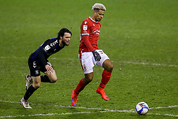 Lyle Taylor of Nottingham Forest takes on Jonathan Howson of Middlesbrough - Mandatory by-line: Robbie Stephenson/JMP - 20/01/2021 - FOOTBALL - City Ground - Nottingham, England - Nottingham Forest v Middlesbrough - Sky Bet Championship