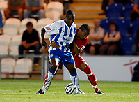 Football Carling Cup First Round Colchester United v Leyton Orient Kevin Lisbie of Colchester United Tamika Mkandawire of Leyton Orient  at Weston Homes Community Stadium, Colchester 11/08/2009 Credit: Colorsport / Kieran Galvin