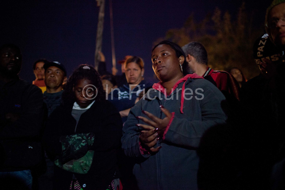Residents look anxious on the eve of the eviction. Isidoro occupation in Belo Horizonte, Minas Gerais in a large  amount of land that was occupied by the MLB, a Brazilian workers social movement, it faced eviction in July / August 2014. (photo by Phil Clarke Hill/In Pictures via Getty Images)