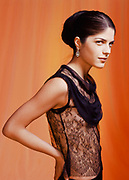 Actress Selma Blair posing in a black evening dress wearing an earing made from a Meteorite.