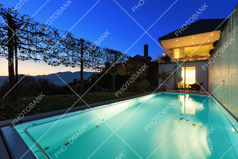 Beautiful swimming pool of a modern house by night