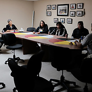 Chad Henry (right), Johnathan Beauchamp (left) and Roberta Jameson (second from left) with young members of the community in the boardroom of the band office at the Ochiichagwe'Babigo'Ining Ojibway Nation reserve (also known as the Dalles First Nation) in Northern Ontario, Canada on 19 December 2016. Henry, a former president of the band's youth council, is responsible for operations and maintenance tasks on the Nation's reserve, but in 2013, together with a council of the community's youth, he initiated a project to erect a tower to bring broadband Internet access to the reserve. The council is now less active, and the adult leadership of the band are struggling to engage young residents in management and governance activities. Henry called this meeting to encourage younger residents to sit on a number of issue-based councils, but only three young residents came.