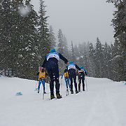 Winter Olympics, Vancouver, 2010.Cross Country skiers on course during snow at The Whistler Olympic Park, Whistler, during the Vancouver  Winter Olympics. 11th February 2010. Photo Tim Clayton