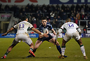 Sale Sharks centre Luke James looks for a gap between London Irish centre Curtis Rona and London Irish wing Ben Loader during a Gallagher Premiership Rugby Union match won by Sharks 39-0, Friday, Mar. 6, 2020, in Eccles, United Kingdom. (Steve Flynn/Image of Sport)