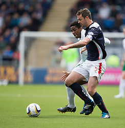 Hibernian's Dominique Malonga and Falkirk's David McCracken. <br /> Falkirk 0 v 3 Hibernian, Scottish Championship game played at The Falkirk Stadium 2/5/2015.