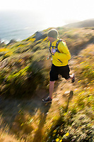 Young man running near the California Coastal Trail; Golden Gate National Recreation Area. San Francisco,  CA.