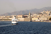 A ferry entering the port of Messina, Straits of Messina, stretto di Messina between the island of Sicily and main land Italy, July 2006