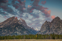 """Sunrise moon over Cascade Canyon of the Grand Tetons in Grand Teton National Park.<br /> <br /> For production prints or stock photos click the Purchase Print/License Photo Button in upper Right; for Fine Art """"Custom Prints"""" contact Daryl - 208-709-3250 or dh@greater-yellowstone.com"""