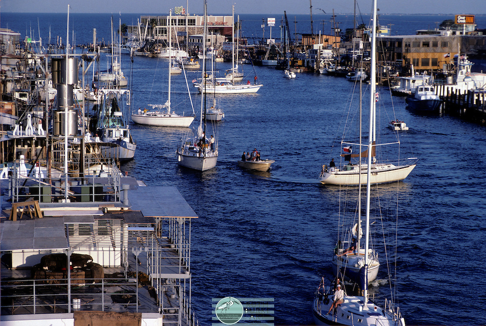 1983 Seabrook and Kemah waterfront with restaurants and crowded boats in channel