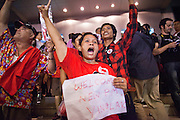 03 JULY 2011 - BANGKOK, THAILAND:    A woman in Bangkok holds up a sign welcoming Yingluck Shinawatra to the Prime Minister's office after it was announced that Yingluck Shinawatra won the Thai elections Sunday night. Yingluck Shinawatra and the Pheu Thai Party scored a massive landslide win in the Thai election Sunday. Pheu That is estimated to have won more than 300 seats in Thailand 500 seat parliament, so they won an absolute majority and could govern without having to form a coalition with minor parties. Pheu Thai is the latest incarnation of deposed former Prime Minister Thaksin Shinawatra's political party. Yingluck is his youngest sister. Many observers expect legal challenges to the Pheu Thai victory and the election does not completely resolve Thailand's difficult political history of the last five years.   PHOTO BY JACK KURTZ
