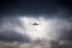 © Licensed to London News Pictures. 13/09/2017. Leeds UK. A Ryan Air aircraft breaks through the dark storm clouds as it approaches Englands highest airport, Leeds Bradford Airport. Photo credit: Andrew McCaren/LNP