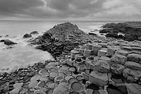 Surging coastal waters surround Giant's Causeway in Northern Ireland.