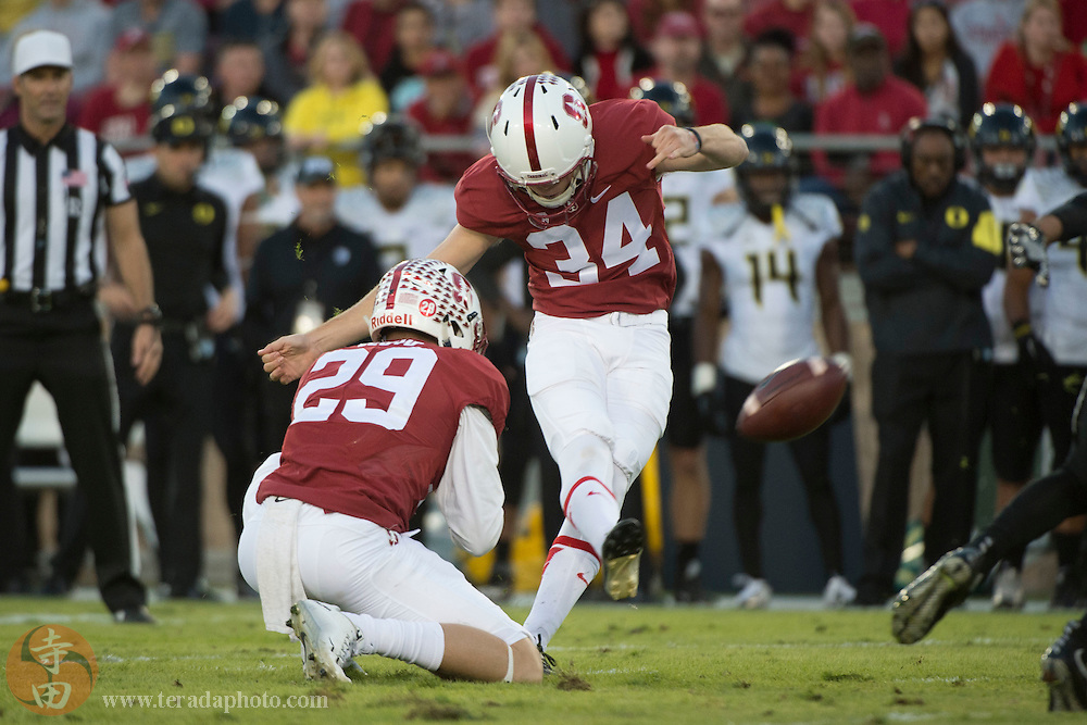 November 14, 2015; Stanford, CA, USA; Stanford Cardinal place kicker Conrad Ukropina (34) kicks a field goal out of the hold by safety Dallas Lloyd (29) during the first quarter against the Oregon Ducks at Stanford Stadium.