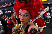 An American woman dressed as the Queen of Hearts during he Halloween celebrations Shibuya, Tokyo, Japan. Saturday October 27th 2018. The celebrations marking this event have grown in popularity in Japan recently. Enjoyed mostly by young adults who like to dress up, drink , dance and misbehave in parts of Tokyo like Shibuya and Roppongi. There has been a push back from Japanese society and the police to try to limit the bad behaviour.