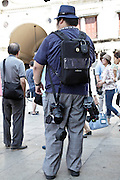 tourist with film and photo equipment
