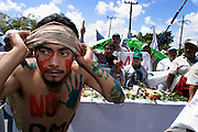 10 SEPTEMBER 2003 - CANCUN, QUINTANA ROO, MEXICO: Anti-globalization protestors opposed to the World Trade Organization and globalization march through the city of Cancun, Quintana Roo, Mexico during a protest against the WTO. Tens of thousands of people opposed to the WTO have come to this Mexican resort city to protest the 5th Ministerial meeting of the World Trade Organization. The WTO meetings are taking place in the hotel zone of Cancun, about 10 miles from the protestors.  PHOTO BY JACK KURTZ