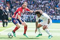 Real Madrid Marcelo and Atletico de Madrid Juanfran Torres during La Liga match between Real Madrid and Atletico de Madrid at Santiago Bernabeu Stadium in Madrid, Spain. April 08, 2018. (ALTERPHOTOS/Borja B.Hojas)