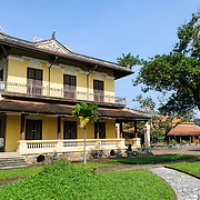 A residential building at the Imperial City in Hue, Vietnam. A self-enclosed and fortified palace, the complex includes the Purple Forbidden City, which was the inner sanctum of the imperial household, as well as temples, courtyards, gardens, and other buildings. Much of the Imperial City was damaged or destroyed during the Vietnam War. It is now designated as a UNESCO World Heritage site.