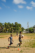 EL TRIUNFO DE LA CRUZ, HONDURAS - Boys run during a soccer practice in the hometown of Allan Modesto Martinez Alvarez, a migrant who was deported from the United States at least twice before dying near Douglas, Arizona while trying to cross the border from Mexico, March 6, 2019.