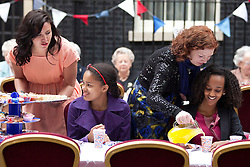 LOCATION, UK  29/04/2011. The Royal Wedding of HRH Prince William to Kate Middleton. Children are served refreshments at a street party held on Downing Street to celebrate the Royal Wedding. Guests at the party included people from the local community, local school children and charities who work with both the young and old. Photo credit should read Matt Cetti-Roberts/LNP. Please see special instructions. © under license to London News Pictures